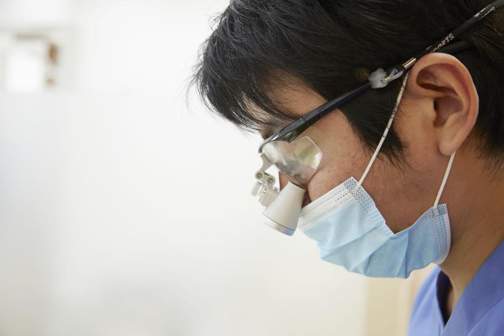 拡大鏡精密治療による痛み軽減